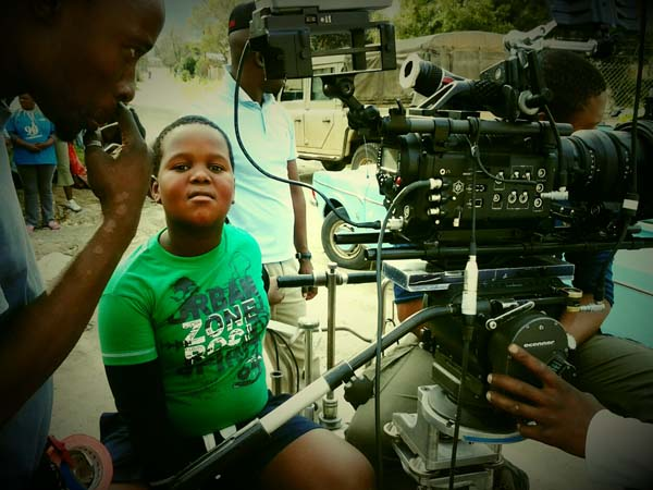 actor Lihlebo Magugu behind the scenes in Of Good Report
