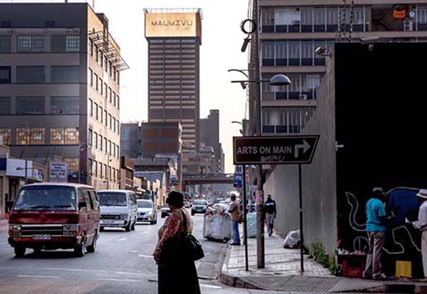 Faith47 artwork on xenophobia lights up Joburg skyline