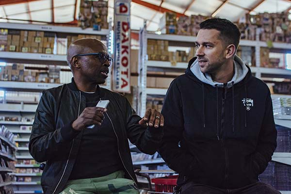 Vinny da Vinci and Kid Fonque have a chat at a music warehouse (Jonathan FerreiraRed Bull Content Pool)